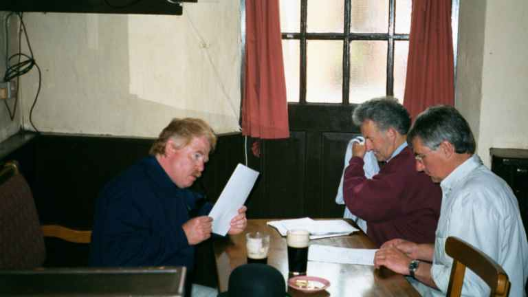 Neville and Bangsy discuss the itinerary with Dick O'Connell
